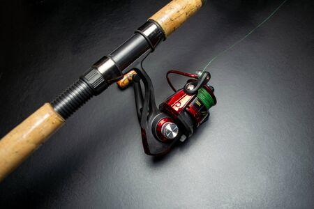 Fishing rod on a black background Foto de archivo