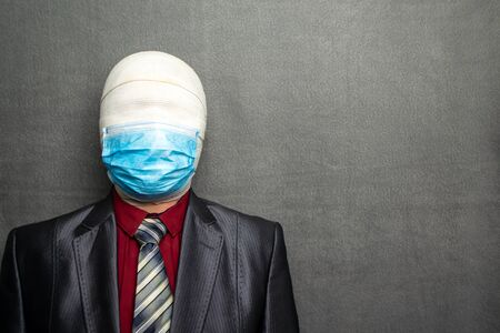 Incognito man in a medical mask is dressed in a business suit