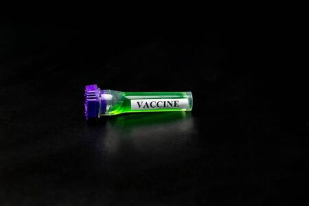 Vaccine in vitro on a black background Stock Photo