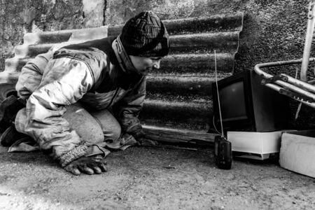 Homeless dirty woman listens to radio music