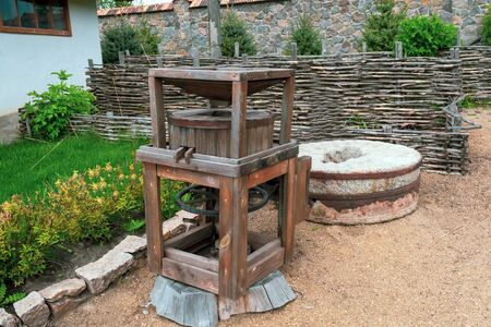 Old wooden mill with stones for grain