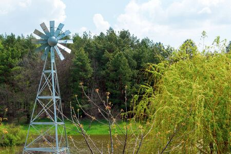 Aeration pumps and windmills. Sunlit windmill close-up