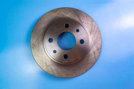 Auto parts, brake discs, pads. Disk on a blue background Stock fotó