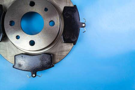Auto parts, brake discs, pads Blue background Stock fotó