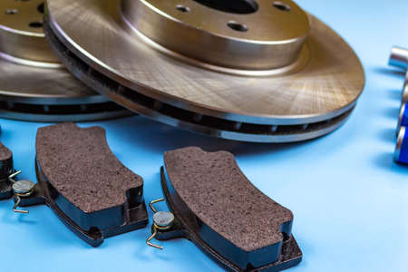Auto parts, brake discs, pads Blue background 写真素材