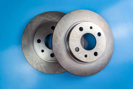 Auto parts, brake discs, pads. Two brake discs on a blue background