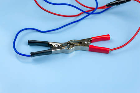 Jumper cable, on a blue background. close-up