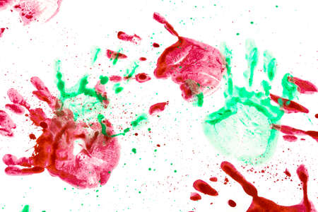 Children's creativity hand prints of different colors on white paper. Beautiful background