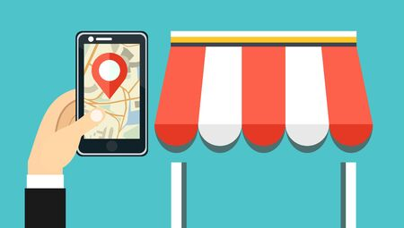 gps navigator: Hand holding smartphone with city map and store location on screen and store icon. Mobile navigation, gps navigator, route concepts.