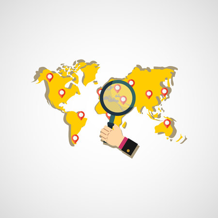 national geographic: Hand holding magnifying glass on world map.