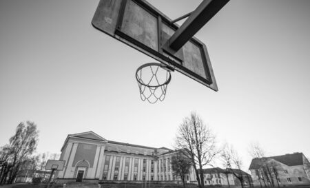 grundge: old school building and basketball hoop, black and white