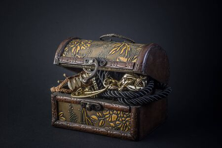 yellow adventure: Chest full of gold, isolated. Black background