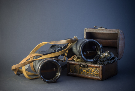antique binoculars: Old vintage Binoculars with treasure. Black background. Close up. Stock Photo