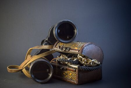 antique binoculars: Old vintage Binoculars with treasure. Black background. Close up. Stock Photo