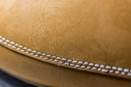 shoe string: Classic Yellow Leather Shoes, Genuine. Unique Style, Handmade Craftsmanship. Close up, Focus on Details. Macro view on leather. Stock Photo