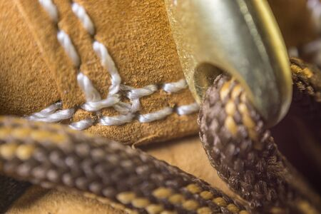 shoe strings: Classic Yellow Leather Shoes, Genuine. Unique Style, Handmade Craftsmanship. Close up, Focus on Details. Macro view on laces. Stock Photo
