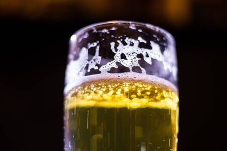 Glass of beer. Black background. Stock Photo