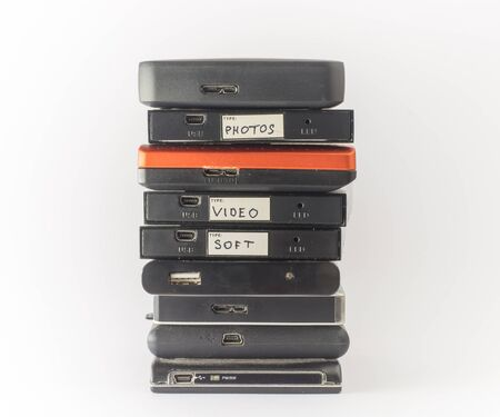 external: Bunch of external hard drives. Isolated on white. Close up.