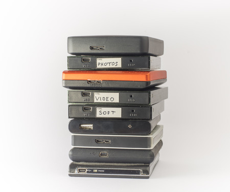 terabyte: Bunch of external hard drives. Isolated on white. Close up.