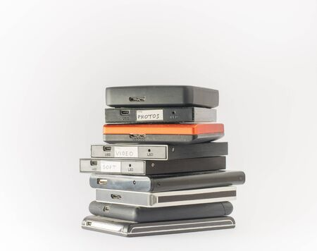 remote server: Bunch of external hard drives. Isolated on white. Close up.