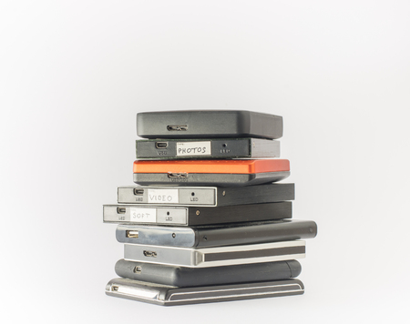 portable hard disk: Bunch of external hard drives. Isolated on white. Close up.
