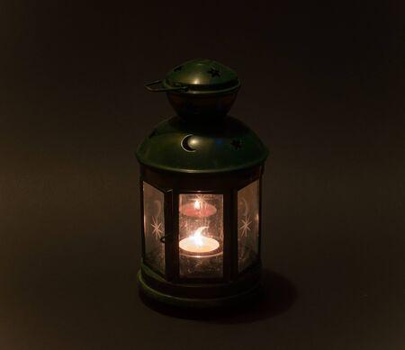 candle holder: Vintage candle holder. Burning candle close up. Stock Photo