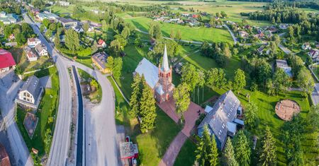 Aerial view of catholic church at sunset. Beautiful sunset at countryside. Panorama