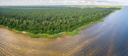 Aerial shot along the coast. Forest. Lake. Panorama. Banco de Imagens