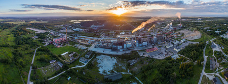 erial view Oil refinery with a background of mountains and sky at sunset. Aerial photography. Kohtla-Järve city, Estonia, Ida-Virumaa. Panorama.