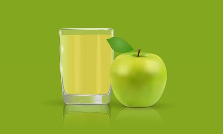 Fresh apple juice in a glass cup on a green background
