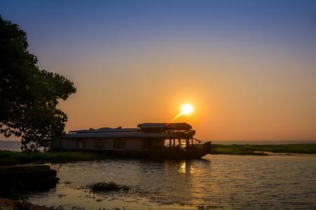evening view of houseboat on Vembenad lake, kerala