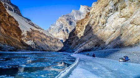 panoramic view of frozen Zanskar river and surrounding mountains during Chadar trek