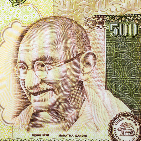 A closeup of Gandhi on a five hundred rupee note   Stock Photo