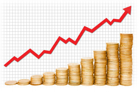 A red graph going up over stacks of gold coins