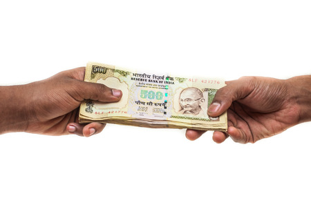 A thick stack of 500 rupee notes changing hands  Stock Photo