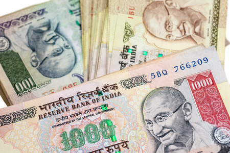 Piles of large bills in Indian currency