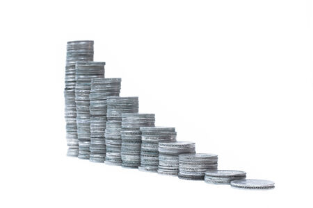 Conceptual graph  Stacks of silver coins isolated on white  Stock Photo