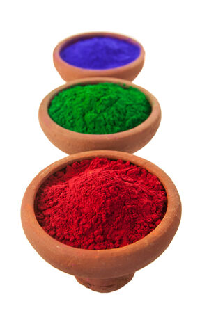 3 bowls of colored dye in a line.