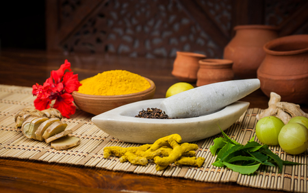 A selection of natural ingredients arranged in and around a marble mortar and pestle. Stock Photo - 51620071