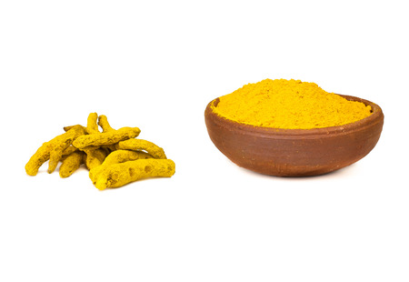 Turmeric Root and Turmeric Powder - Isolated on White.
