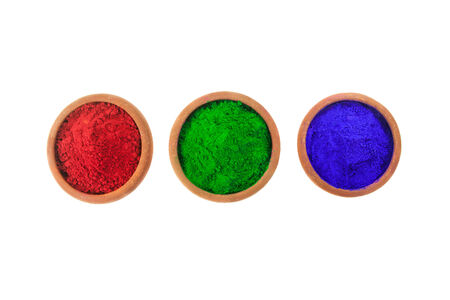 Red, Green and Blue (RGB) colored dyes in earthen bowls isolated on white. Stock Photo