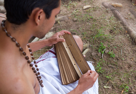 vedas: A young brahmin reads an ancient Hindu text.
