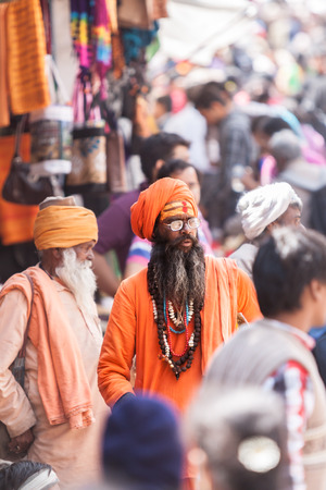 BADARINATH  INDIA, JUNE 5th - A sadhu amongst pilgrims on the streets near the temple of Badarinath in North India on June 5th 2013