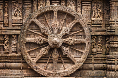 A chariot wheel carved into the wall of the sun temple at Konark, India.