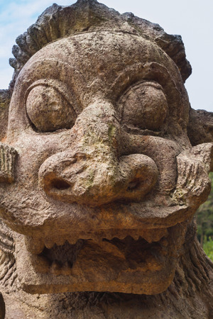 caved: A gargoyle caved from sandstone at the ancient sun temple at Konark, India.