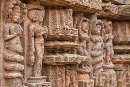 deities: Ancient carvings of dancers and Nagas (half men, half snake deities) at the Sun Temple in Konark, India.