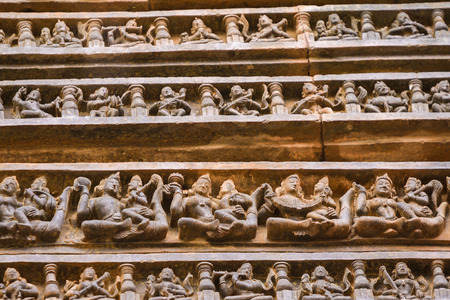 Ancient sandstone carvings on the walls of the ancient sun temple at Konark, India.
