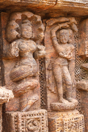 deities: Ancient carvings of dancers and Nagas half men, half snake deities at the Sun Temple in Konark, India.