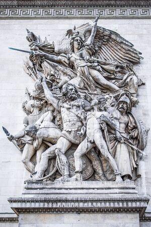 charles de gaulle: rc de Triomphe de lEtoile on Charles de Gaulle Place, Paris, France. Main sculptural groups on each of the Arcs pillars. Arc is one of the most famous monuments in Paris. Stock Photo