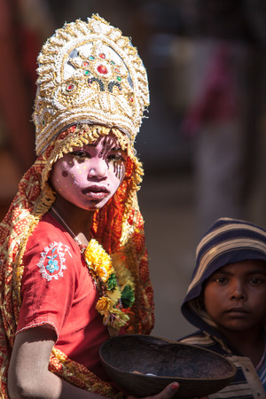 GANGOTRI, INDIA - MAY 23rd - A young child dressed as the Goddess Ganga begging at Gangotri on 23rd May 2013 Editorial